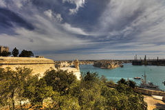 Valletta city harbor area at Malta, with many historic buildings along the coastline.  Royalty Free Stock Image