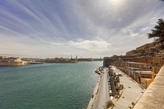 Valletta city harbor area at Malta, with many historic buildings along the coastline.  Stock Photography