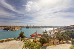 Valletta city harbor area at Malta, with many historic buildings along the coastline.  Stock Photos