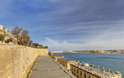 Valletta city harbor area at Malta, with many historic buildings along the coastline.  Stock Photo