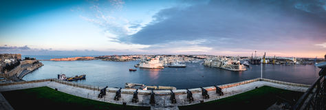 Valletta fortress at dusk - Malta. Panorama Stock Photo