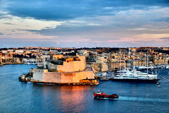 Valletta fortress at dusk - Malta. Panorama. Fort Saint Angelo Royalty Free Stock Photos