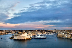 Valletta fortress at dusk - Malta. Panorama. Fort Saint Angelo Stock Image