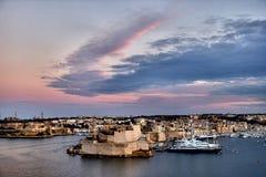 Valletta fortress at dusk - Malta. Panorama. Valletta fortress at dusk - Malta. Panoramic view Royalty Free Stock Photo