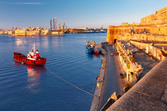 Valletta and the Grand Harbor at dawn. Malta. Lascaris Battery, with the Saluting Battery and the Upper Barrakka Gardens, Senglea, Church of Our Lady of Liesse Stock Photos