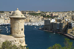 Valletta harbour. A view of Valletta harbour in Malta, with an old watchtower in the foreground Stock Images