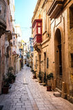 Valletta iconic narrow city streets at sunset.  Stock Photography