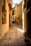 Valletta iconic narrow city streets at sunset.  Royalty Free Stock Photos
