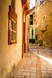 Valletta iconic narrow city streets at sunset.  Royalty Free Stock Images