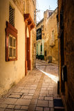 Valletta iconic narrow city streets at sunset.  Stock Photo