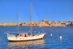 Valletta, Malta. Sailboat and the city of Valletta in Malta Stock Photos