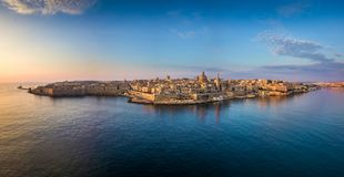 Valletta, Malta - Aerial panoramic skyline of Valletta at sunrise with Our Lady of Mount Carmel church. And St.Paul`s Anglican Cathedral Royalty Free Stock Photos
