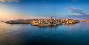 Valletta, Malta - Aerial panoramic skyline of Valletta at sunrise with Our Lady of Mount Carmel church. And St.Paul`s Anglican Cathedral Stock Photo