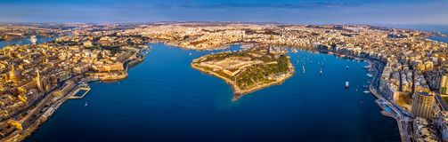 Valletta, Malta - Aerial panoramic skyline view of Valletta, Sliema, Manoel Island, Gzira, Ta` Xbiex. Msida and Floriana at sunrise Royalty Free Stock Image