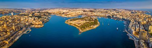 Valletta, Malta - Aerial panoramic skyline view of Valletta, Sliema, Manoel Island. Gzira, Ta` Xbiex, Msida and Floriana at sunrise Stock Images