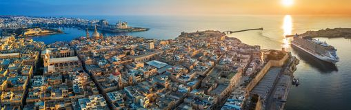 Valletta, Malta - Aerial panoramic view of Valletta with Mount Carmel church, St.Paul`s and St.John`s Cathedral. Manoel Island, Fort Manoel, Sliema and cruise Royalty Free Stock Photography
