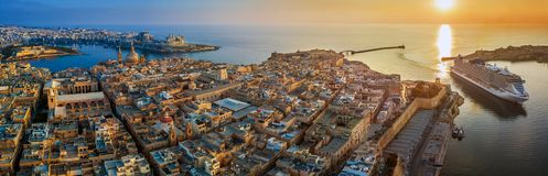 Valletta, Malta - Aerial panoramic view of Valletta with Mount Carmel church, St.Paul`s and St.John`s Cathedral. Manoel Island, Fort Manoel, Sliema and cruise Stock Photo