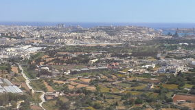 Valletta Malta aerial view. Bird's eye view of Mediterranean island of Malta capital Valletta from descending aircraft window stock video footage