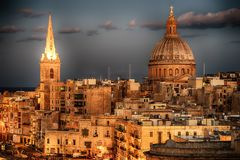 Valletta, Malta: aerial view from city walls. The cathedral. Valletta, Malta: aerial view from city walls at sunset. The cathedral Stock Photo