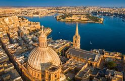 Valletta, Malta - Aerial view of Our Lady of Mount Carmel church, St.Paul`s Cathedral and Manoel Island. At sunrise Stock Image