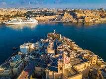Valletta, Malta - Aerial view of Senglea, Gardjola Gardens, Saluting Battery, Upper Barrakka Gardens. And Grand Harbor with Cruise ship at sunrise Royalty Free Stock Photos