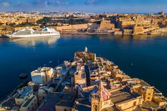 Valletta, Malta - Aerial view of Senglea, Gardjola Gardens, Saluting Battery, Upper Barrakka Gardens. And Grand Harbor with Cruise ship at sunrise Royalty Free Stock Photography