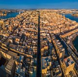 Valletta, Malta - The ancient city of Valletta from above with Triq Ir-Repubblika, the narrow high street of Valletta. At sunrise Stock Image