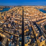 Valletta, Malta - The ancient city of Valletta from above with Triq Ir-Repubblika. The narrow high street of Valletta at sunrise Stock Image