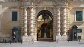 VALLETTA - MALTA, April, 2018: Honor guard near the palace of the Grand Master in the ancient city of Valletta, Malta. VALLETTA - MALTA, April, 2018: Honor Royalty Free Stock Image