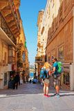 People at typical Maltese street in Valletta Stock Images