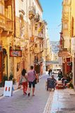 People in typical Maltese street in Valletta Stock Photo