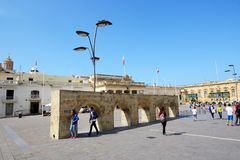 The tourists are on the St George Square. VALLETTA, MALTA - APRIL 21: The tourists are on the St George Square on April 21, 2015 in Valletta, Malta. More then 1 Royalty Free Stock Photos