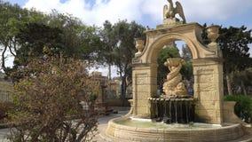VALLETTA - MALTA, April, 2018: Walking in the park in the direction of Valletta, Malta. VALLETTA - MALTA, April, 2018: Walking in the park in the direction of stock video footage