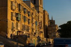 Sunset in Valletta, Malta. VALLETTA, MALTA - AUGUST 21, 2017: Valletta the beautiful capital city of Malta is visited daily by crowds of tourists. Sunset lights Royalty Free Stock Photos