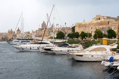 Boats and yachts anchoring in Valletta, Malta Stock Photos