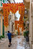 Streets of Valletta during a religious feast. VALLETTA, MALTA - AUGUST 23, 2017: The Feast of St. Dominic is celebrated in the town of Vittoriosa Birgu in Malta Royalty Free Stock Photos