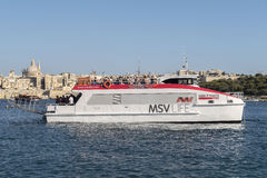 VALLETTA, MALTA. AUGUST 05, 2016: Sliema to Valletta ferry before Sliema dock. The frequent ferry service from Valletta to Sliema covers the distance in about stock image
