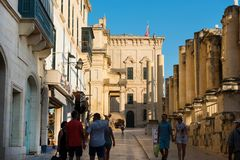 Tourists visiting Valletta city. VALLETTA, MALTA - AUGUST 21, 2017: Tourists walking in Valletta city and enjoying a plenty sunny afternoon in the historical Stock Images