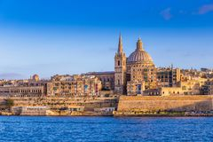 Valletta, Malta - The beautiful Saint Paul`s Cathedral and the ancient walls of Valletta in the morning Royalty Free Stock Images