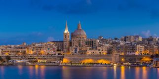 Valletta, Malta - Blue hour at the famous St.Paul`s Cathedral. And the city of Valletta Royalty Free Stock Images