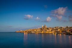 Valletta, Malta - Blue hour at the famous St.Paul`s Cathedral. And the city of Valletta Royalty Free Stock Photography
