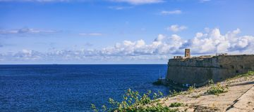 Valletta, Malta. Blue sky and sea view over the fortress wall. Sunny day with a few clouds Stock Photo