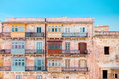 Valletta, Malta, buildings with traditional Maltese balconies.  Royalty Free Stock Photo