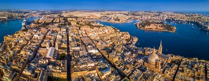 Valletta, Malta - The capital city of Malta from above on a panoramic shot with Our Lady of Mount Carmel church. St.Paul`s Cathedral and Manoel Island at Royalty Free Stock Photo