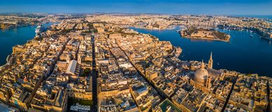 Valletta, Malta - The capital city of Malta from above on a panoramic shot with Our Lady of Mount Carmel church. St.Paul`s Cathedral and Manoel Island at Stock Images