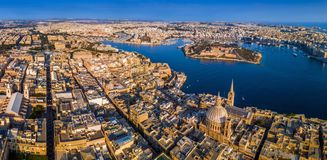 Valletta, Malta - The capital city of Malta from above on a panoramic shot with Our Lady of Mount Carmel church. St.Paul`s Cathedral and Manoel Island at Royalty Free Stock Image