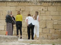 Malta Fashion Week 2019 at Fort St Elmo. VALLETTA, MALTA - CIRCA MAY 2019: Malta Fashion Week 2019 at Fort St Elmo, arrival of participants at the entrance stock photos