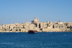 Valletta, Malta. Dome of Roman Catholic Basilica of Our Lady of Mount Carmel. St Paul's Pro-Cathedral landmark tower also visible. The Basilica is part of the stock photography