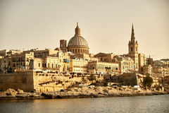 Valletta Malta in the Evening. City of Valletta Malta captured from Silema Bay Stock Photo