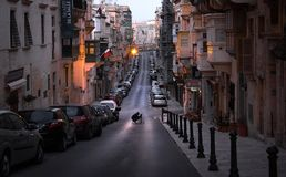 Valletta. Malta. February. 6 in the morning. The streets of the old town of Valletta. Differences in heights, straight streets at dawn. The beauty of the Stock Image